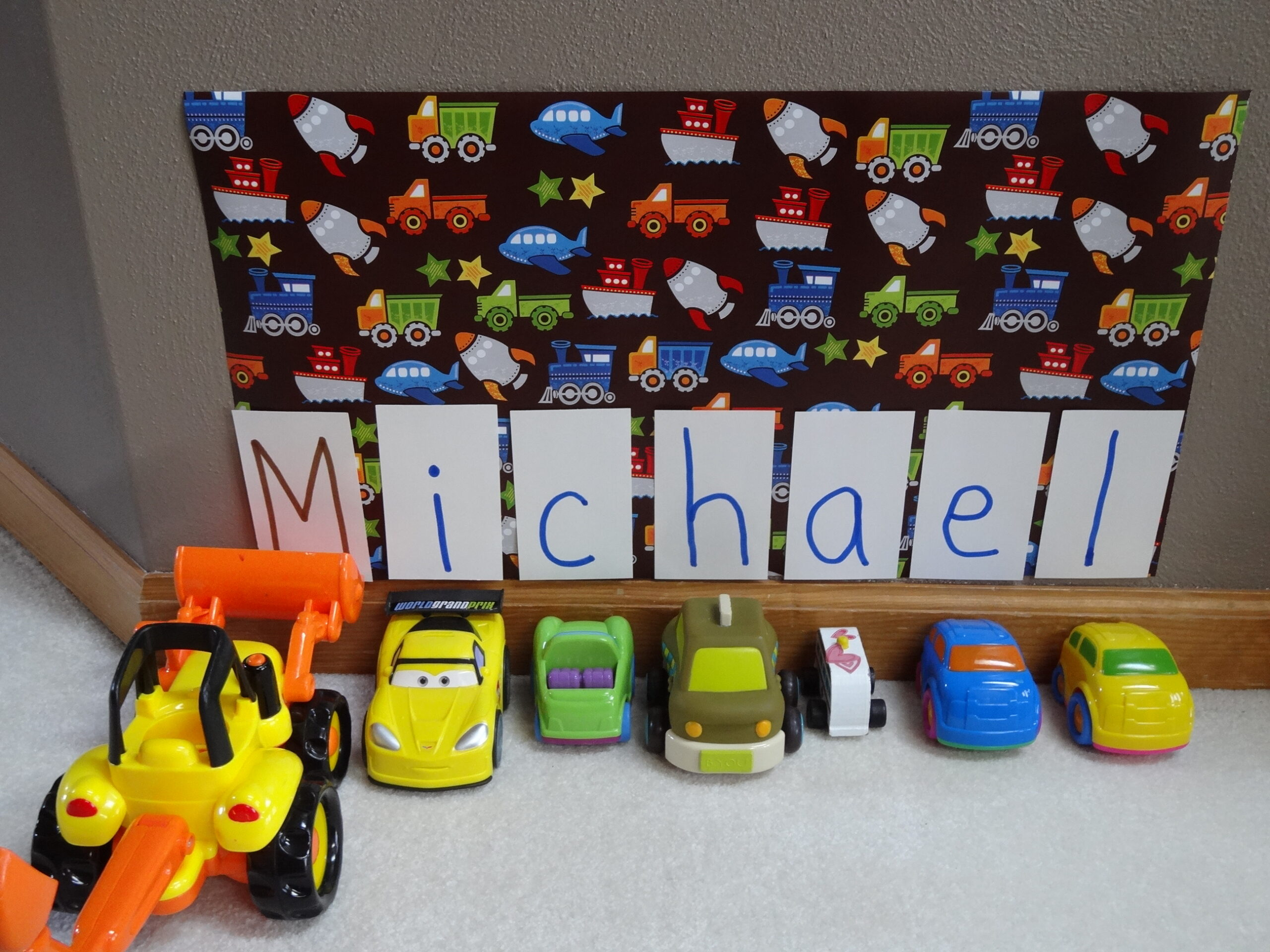 Organize cars and learn to spell your name with this parking garage activity from growingbookbybook.com