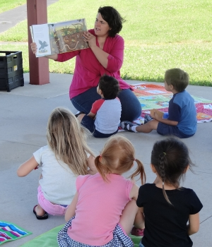 reading to the kids outside during storytime