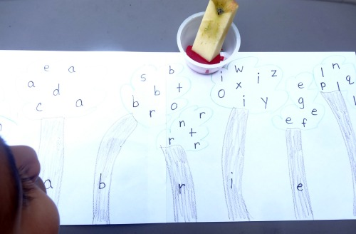 Identify the letters in your name with this apple stamping forest activity from growingbookbybook.com