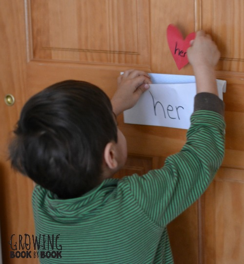placing the hearts in the sight word envelopes