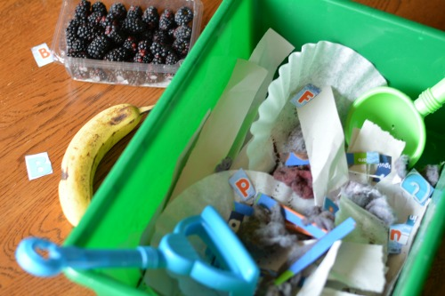 matching letters and sounds with a compost alphabet bin