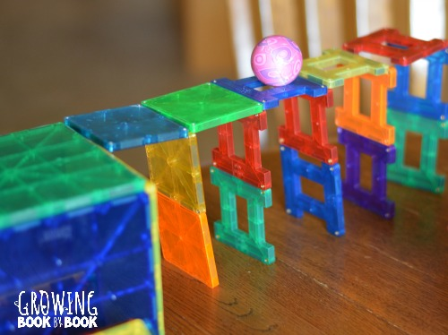 Using Magna Tiles for a ball to cross in this language activity for preschoolers.