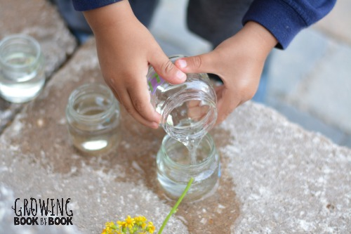 filling the alphabet vases with water