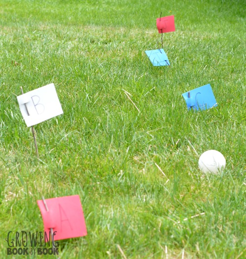 Play flag stick fit ball! It's a fun alphabet activity for kids.