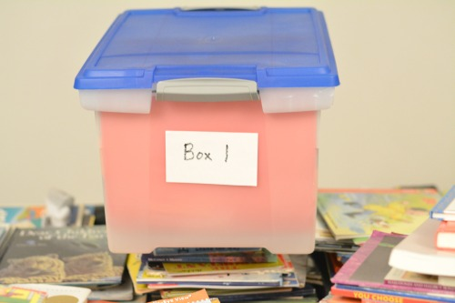 use plastic tubs for book rotations