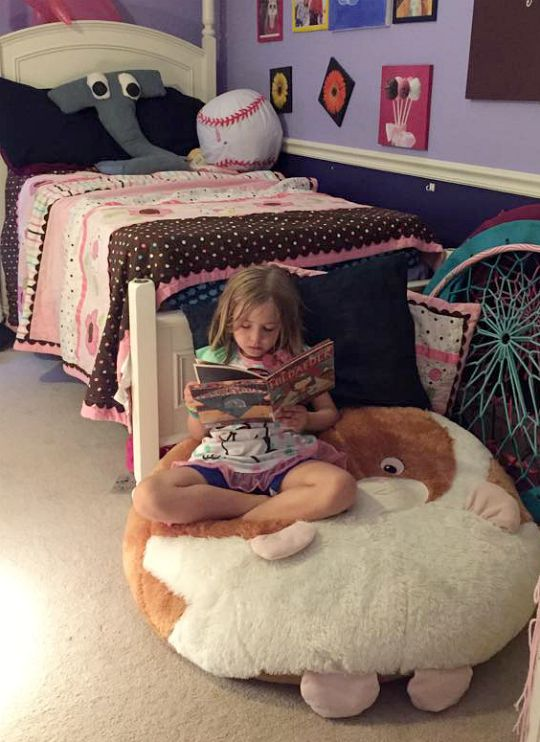 Create a reading nook at the end of a bed.