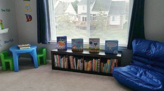 Create a reading nook with a low bookshelf.