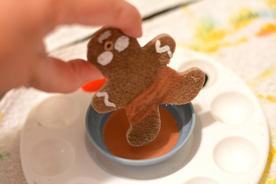 dipping boots in paint for ornaments made of gingerbread salt dough
