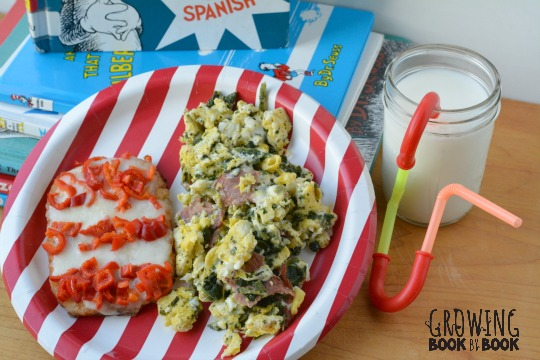 A yummy Dr. Seuss breakfast with green eggs and ham and cat in the hat hash browns