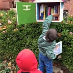 dropping off books at the Little Free Library