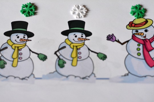 Use snowflake stickers in a snowmen counting book.