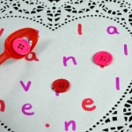 placing buttons on the heart for Valentine's Day