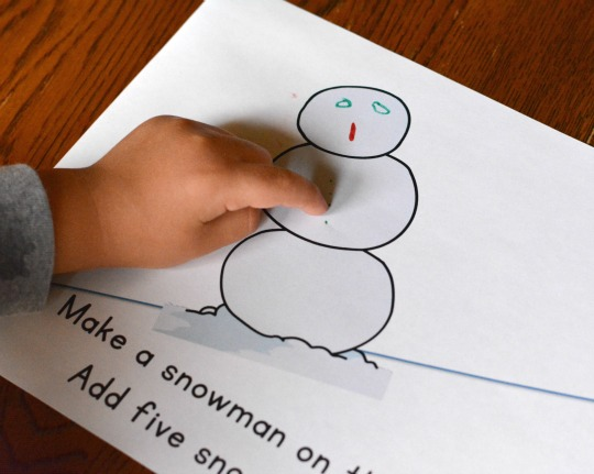 adding snowman details to a free printable book for early readers