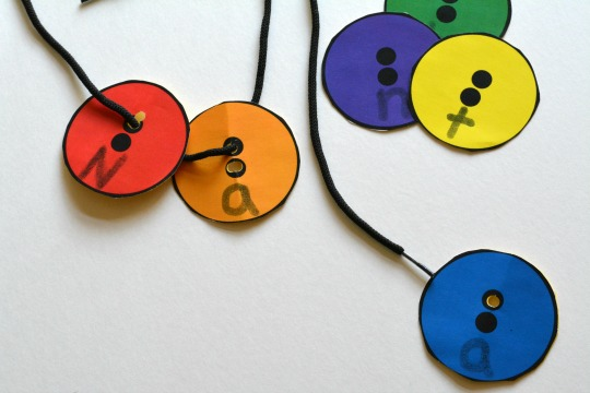 work on fine motor skills with Corduroy inspired button name game