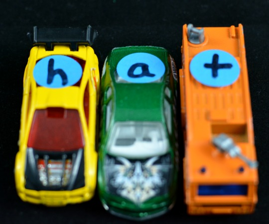 Add letters to cars for a hands-on phonics activity.