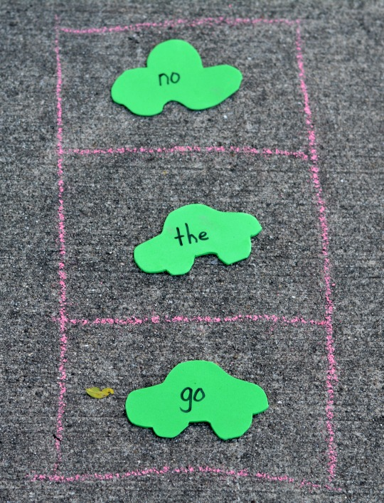 outside activity using chalk, foam sheets, and the tradition red light green light game