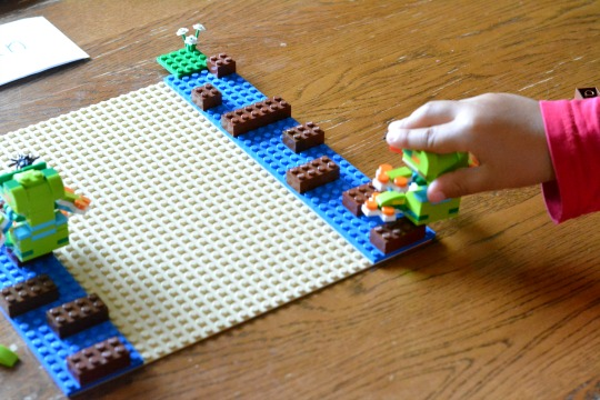 playing a new reader phonics game with Lego