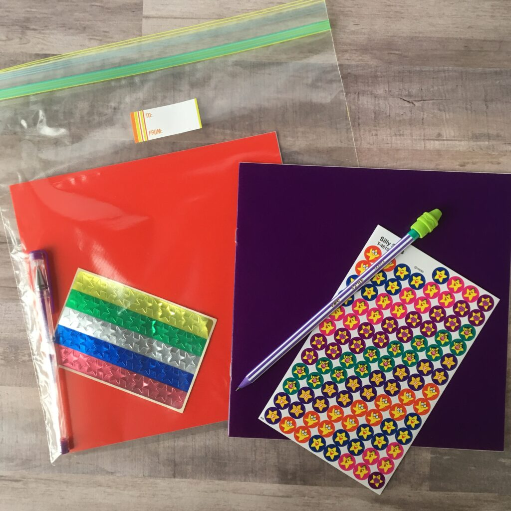 kit made with blank books, stickers and pencils for students
